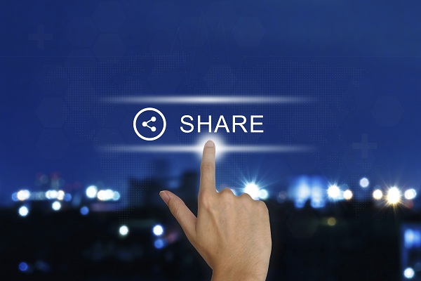 hand clicking share button on a touch screen interface